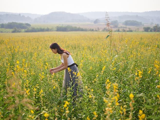 model with flower portraits on medium format camera